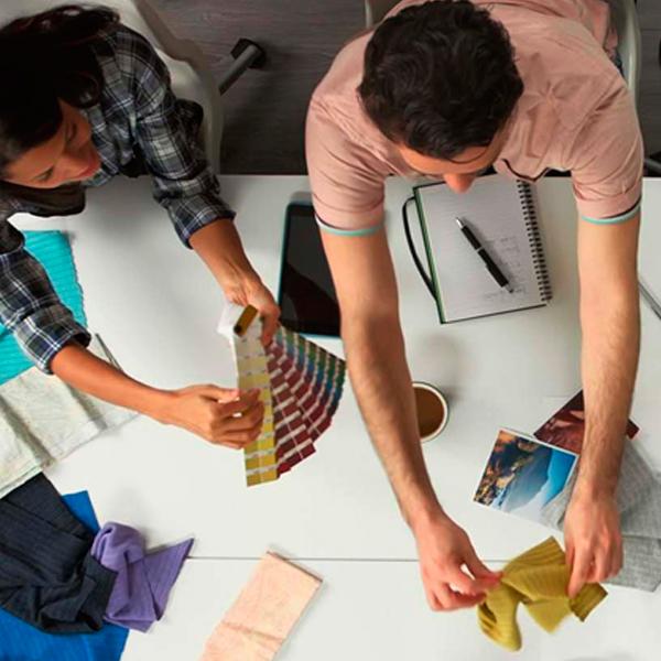 overhead view of a design team, print design, design team
